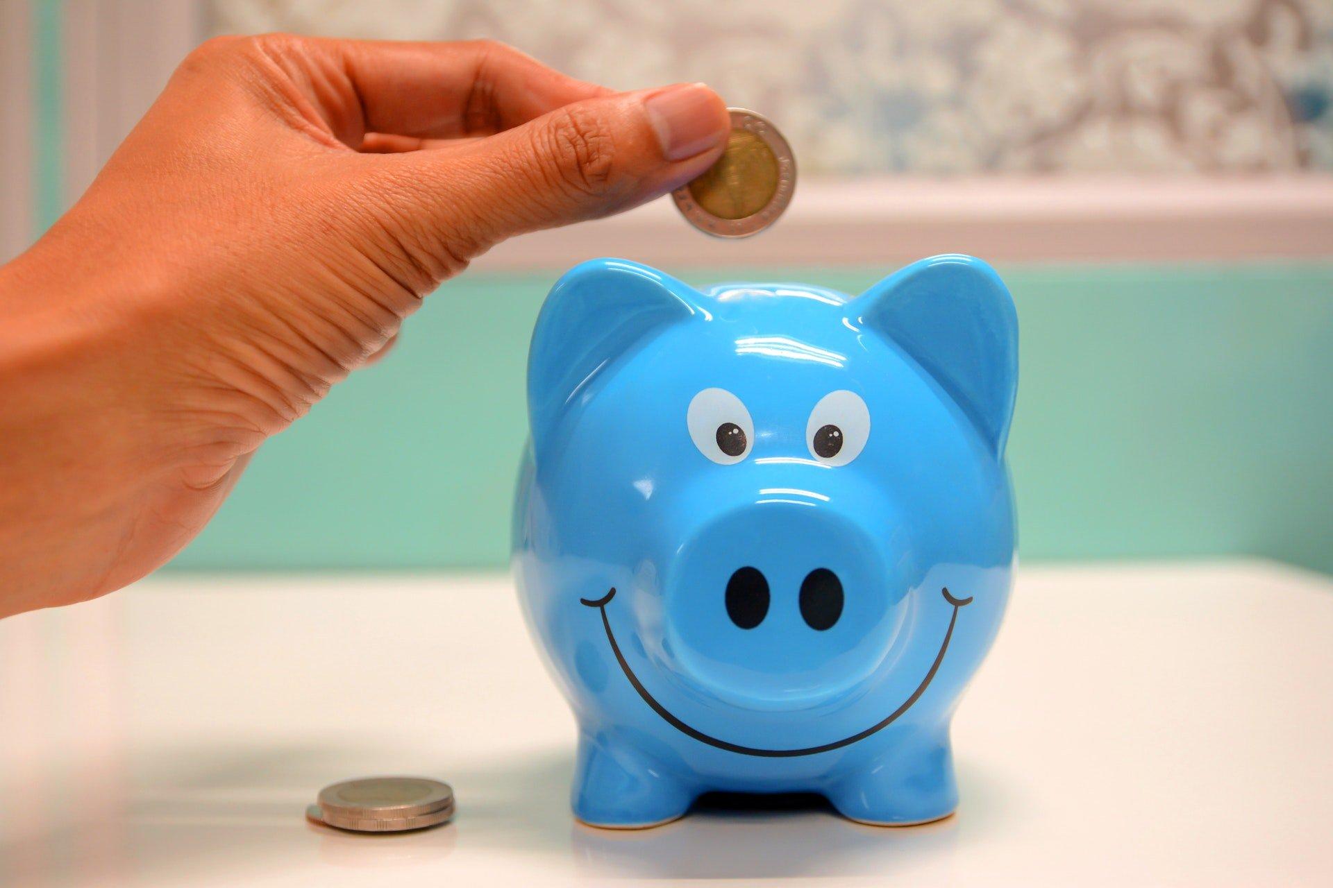 Saving pennies in a piggy bank